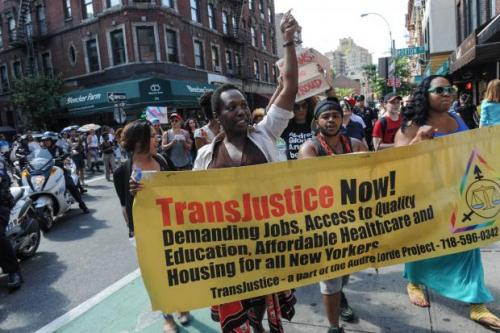 The TransJustice Banner leading a march of over 600 people from the Piers